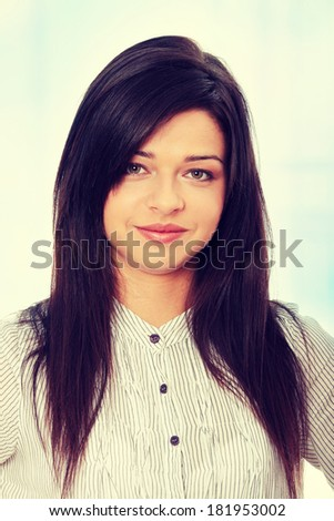 Beautiful smiling woman. Over abstract blue background  - stock photo
