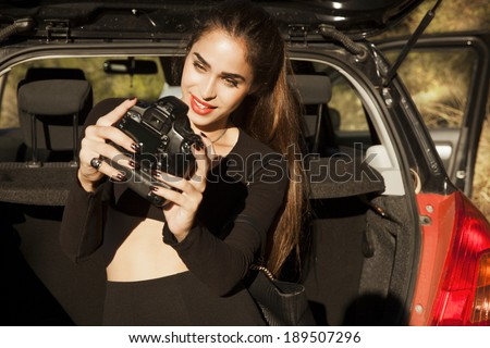 beautiful, smiling woman take a picture of herself with camera. selfie,  outdoors shot, horizontal - stock photo