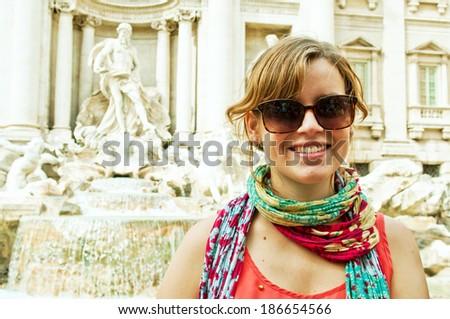 beautiful smiling woman tourist at the famous Trevi Fountain in Rome, Italy - stock photo