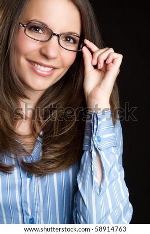 Beautiful smiling woman wearing glasses - stock photo
