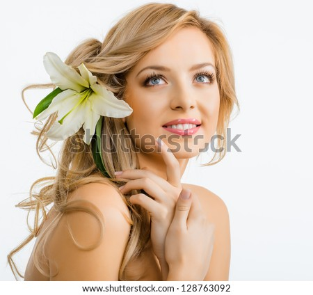 Beautiful smiling woman with a lily - stock photo