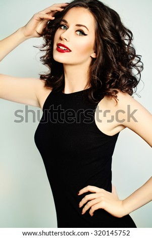 Beautiful Smiling Woman with Curly Hair - stock photo