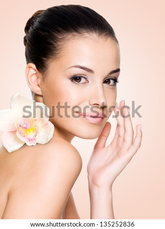 Beautiful smiling woman with healthy skin face. Skin care concept. - stock photo