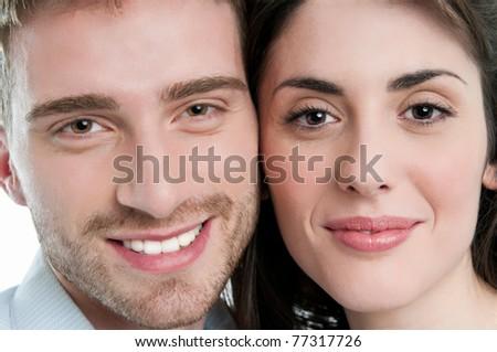 Beautiful smiling young couple closeup faces - stock photo