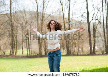 Beautiful smiling young woman dancing - stock photo