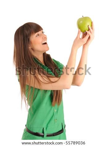 Beautiful smiling young woman holding a green apple, studio shot. - stock photo
