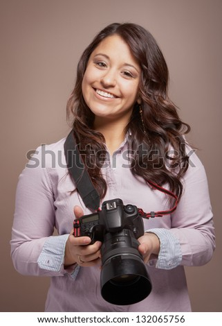 Beautiful smiling young woman photographer with camera - stock photo