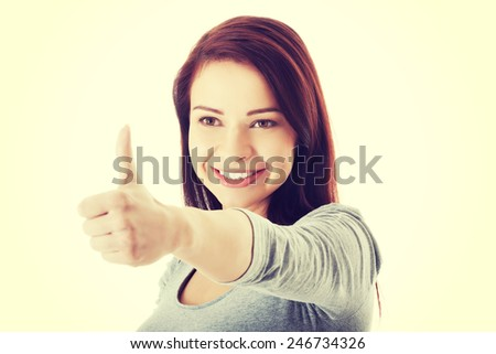 Beautiful smiling young woman showing ok gesture. - stock photo