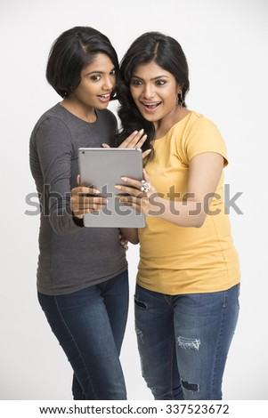 Beautiful Smiling young woman using digital tablet  - stock photo