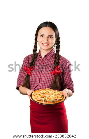 Beautiful smiling young woman with pigtails and red ribbons presenting showing holding a fresh cooked pizza isolated on white background