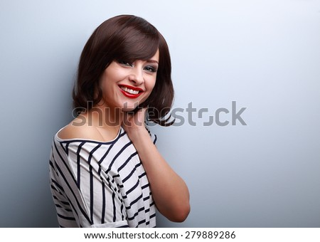 Beautiful smiling young woman with short hair style on blue background - stock photo