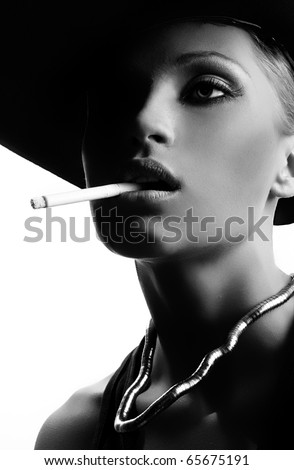 Beautiful smoking woman black white version - stock photo