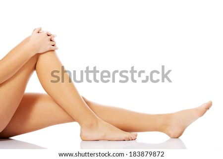 Beautiful, smooth female legs and feet. Isolated on white.