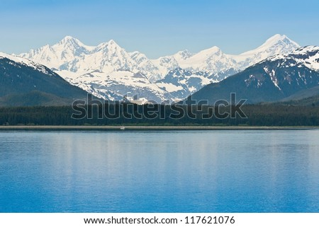 Beautiful snow capped Alaskan  mountain range along the Inside Passage - stock photo