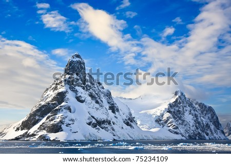 Beautiful snow-capped mountains against the blue sky in Antarctica - stock photo