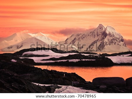 Beautiful snow-capped mountains at sunset in Antarctica - stock photo