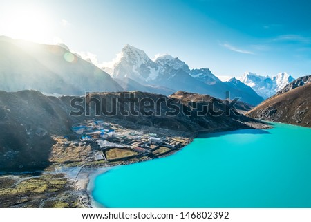 Beautiful snow-capped mountains with lake against the blue sky. Himalaya, Nepal - stock photo