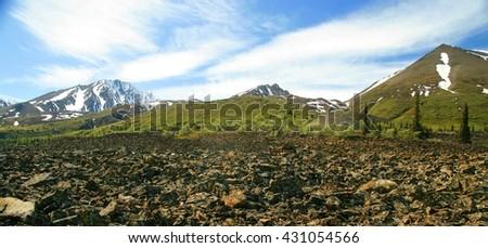 Beautiful snow covered Yukon mountains - stock photo