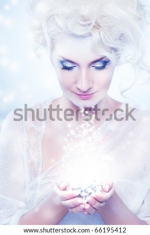 Beautiful snow queen with a christmas decoration - stock photo