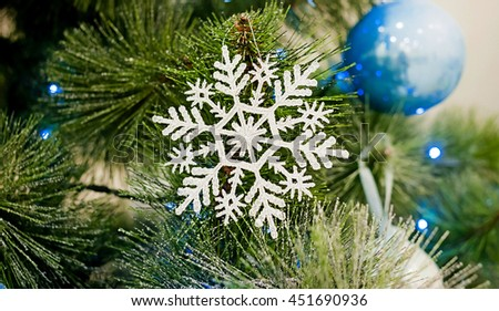 Beautiful snowflake on a Christmas tree. New Year's toy
