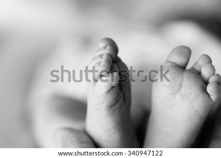 Beautiful Soft newborn baby feet close up