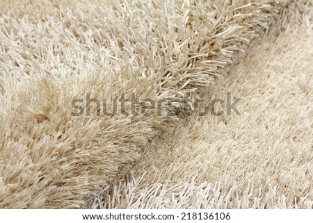 Beautiful soft shaggy carpet of modern design - stock photo