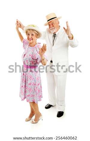 Beautiful Southern senior couple dancing together.  Full body isolated on white.