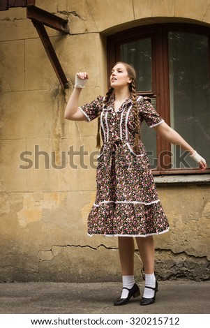 Beautiful soviet girl in retro style is on the Moscow street