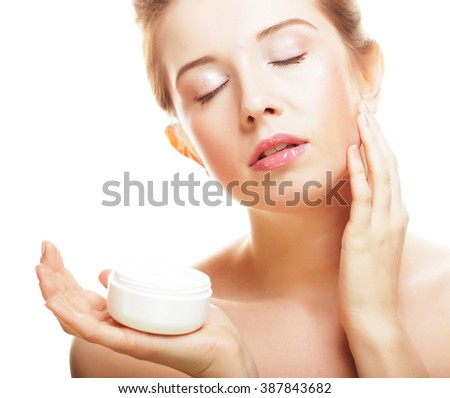 Beautiful spa girl holding jar of cream  - stock photo