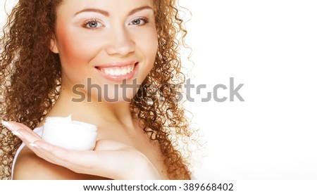 Beautiful spa girl holding jar of cream  - stock photo