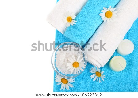 Beautiful spa setting with daisies isolated on white - stock photo