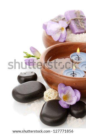 Beautiful spa setting with flowers, isolated on white - stock photo