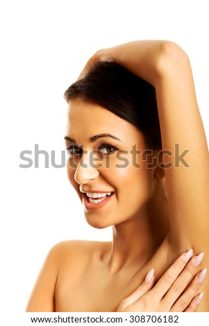 Beautiful spa woman holding hand on head.