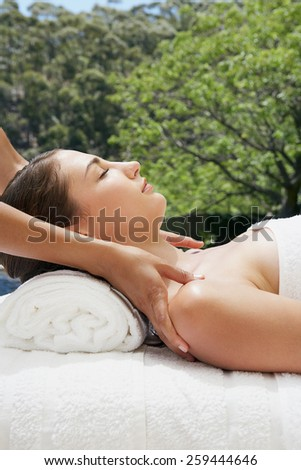 beautiful spa woman lying on a couch, female hands massaged - stock photo
