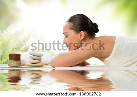 beautiful spa woman lying on the couch, gets pleasure - stock photo