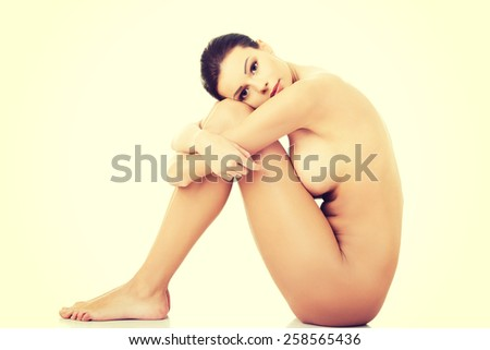 Beautiful spa woman sitting on the floor. - stock photo