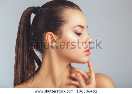 Beautiful Spa Woman Touching her chin. Youth and Skin Care Concept. - stock photo