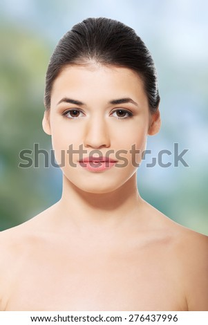 Beautiful spa woman with bare shoulders.