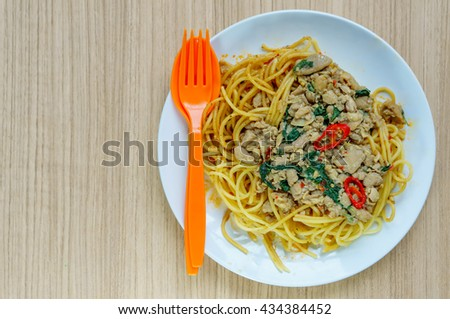 Beautiful spaghetti with minced meat and vegetables on a plate. view from above, select focus - stock photo