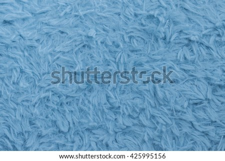Beautiful sparkling artificial blue fur texture background