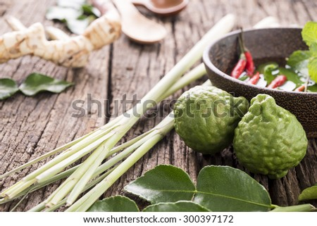 Beautiful spices and herbs on an old dark wooden board - stock photo