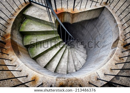beautiful spiral staircase at an emergency exit - stock photo