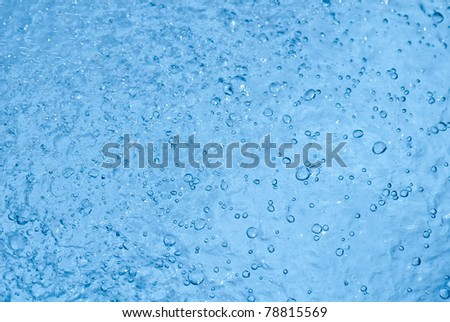 Beautiful splashes of fresh water on a color background