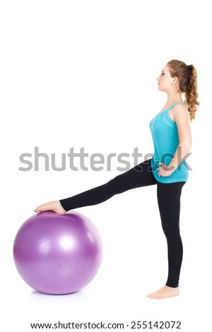 Beautiful sport woman doing stretching fitness exercise on ball. attractive fit woman pilates push up exercise isolated on white. Young woman doing Pilates. woman doing exercises with gym ball. Series - stock photo
