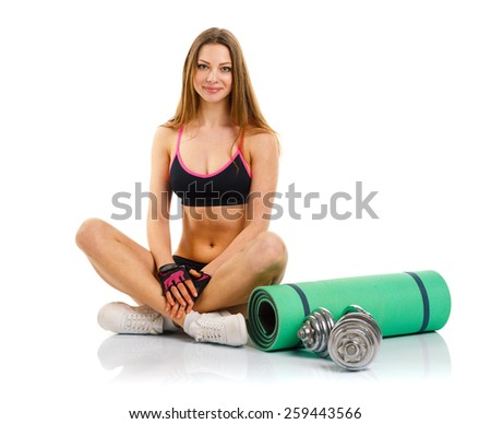 Beautiful sport woman with dumbbells, mat for fitness, doing sport exercise, isolated on white background - stock photo