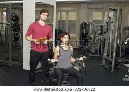 beautiful sports fitness couple in the gym. Fitness instructors with additional equipment, fitness trainer
