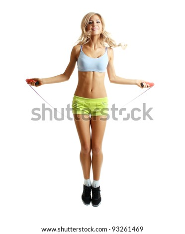 Beautiful sportsgirl with skipping rope isolated on white