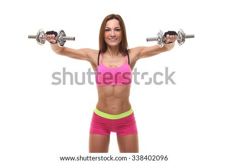 beautiful sporty muscular woman working out with dumbbells