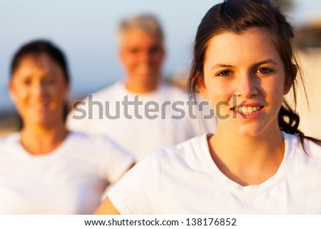 beautiful sporty teenage girl outdoors with parents