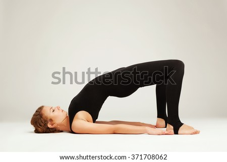 Beautiful sporty woman doing exercise - stock photo